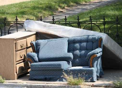 old, sofa, dresser, and mattress at the curb.